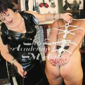 Cleo Dubois demonstrates bondage and caning how to's in her BDSM educational videos